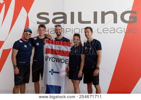 ST. PETERSBURG, RUSSIA - AUGUST 3, 2018: Athletes from Austria make group photo during Semifinal 2 of Sailing Champions League. 25 sailing teams take part in the competitions