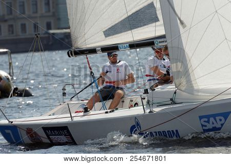 ST. PETERSBURG, RUSSIA - AUGUST 3, 2018: Team VWDTP Groningen from Netherlands compete in Semifinal 2 of Sailing Champions League. 25 sailing teams participate in the competitions