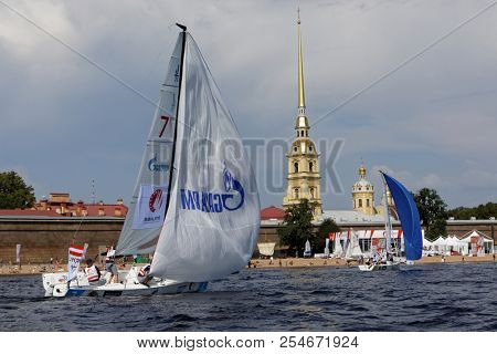 ST. PETERSBURG, RUSSIA - AUGUST 3, 2018: Team UJCW from Austria compete in Semifinal 2 of Sailing Champions League. 25 sailing teams participate in the competitions