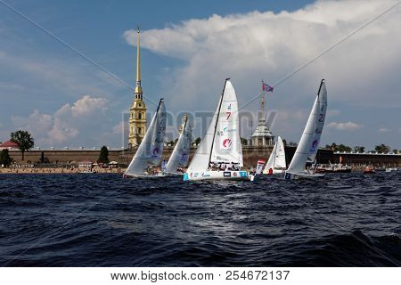 ST. PETERSBURG, RUSSIA - AUGUST 3, 2018: Race of first day of Semifinal 2 competitions of Sailing Champions League at Peter and Paul Fortress. 25 sailing teams participate in the competitions