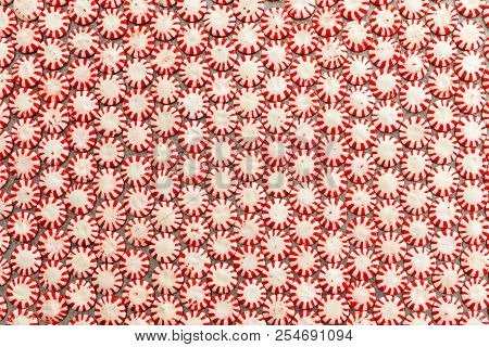 Background Texture And Pattern Of Colorful Striped Red And White Peppermint Flavored Starlight Candi