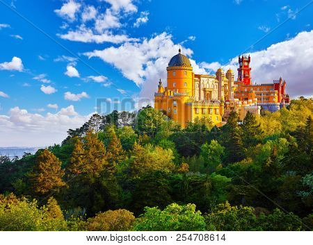 Palace of Pena in Sintra. Lisbon, Portugal. Famous landmark. Summer morning landscape with blue sky.