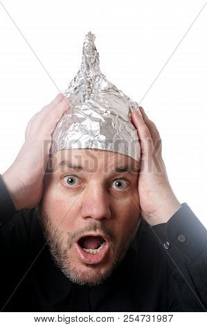 crazy scared man wearing tin foil hat, paranoia or conspiracy theory concept poster