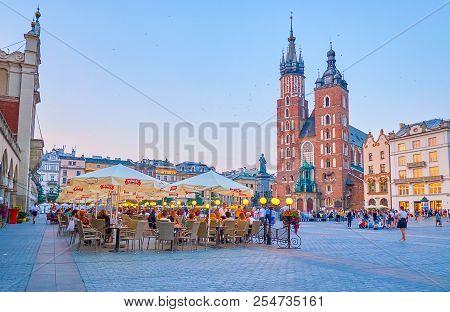 Krakow, Poland - June 11, 2018: Evening Is The Best Time To Walk Along Center Of Krakow Enjoying Bea