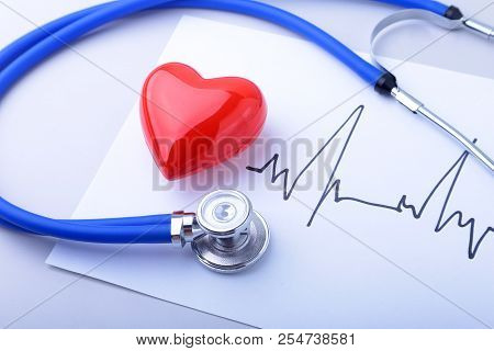 Medical Stethoscope And Red Heart With Cardiogram Isolated On White. Medical Healthcare Concept