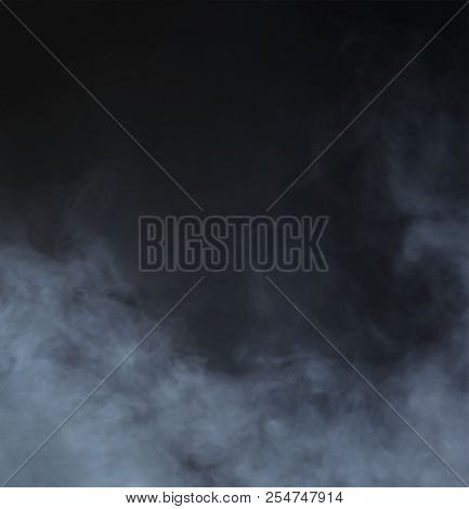 Grey smoke over black background. Abstract background.