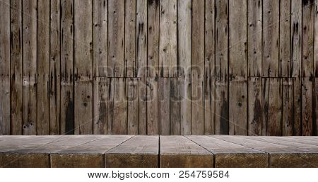 Wooden table and slightly blurred wooden wall