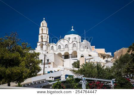 Panoramic view  on church in the center of the Greek village  Emporio at Santorini island, Greece.
