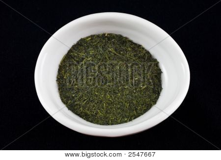 close-up of Japanese green tea in a white bowl on a black background poster