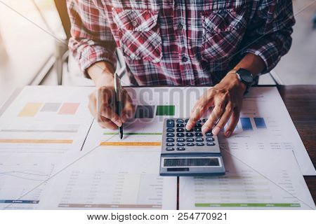 Close Up Of Businessman Working On Calculator To Calculate Business Data The Financial Report. Busin