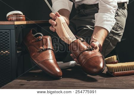 Bootblack Prepares Shoes For Cleaning In His Workshop