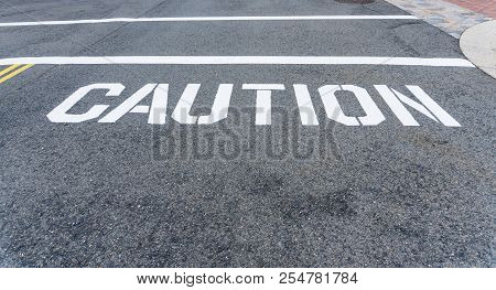 Caution Sign And Line Painted On The Street