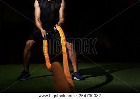 Men With Battle Rope In Functional Training Fitness Gym, Fitness People Exercising With Battle Ropes