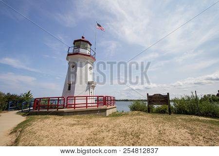 Michigan Lighthouse. Lighthouse On The Lake Huron Coast On The Downtown Waterfront Beach Of Cheboyga