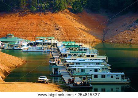 August 15, 2018 In Shasta Lake, Ca:  Rental Houseboats Docked At Holiday Harbor Marina In Shasta Lak