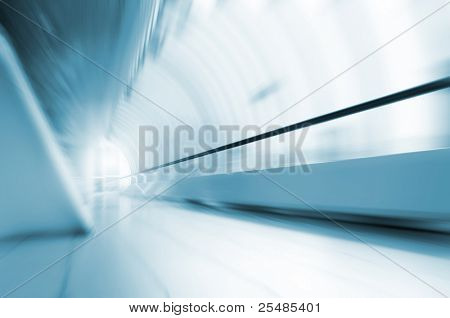 Abstract motion in long corridor in airport