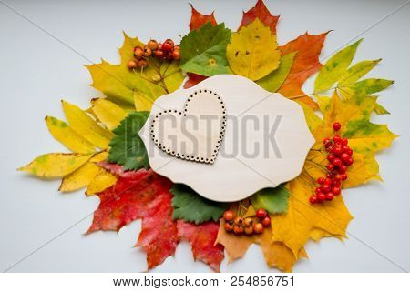Autumn Leaves With Wooden Heart. Symbol For Loving Autumn Season. Autumn Mood. Seasonal Sales. Autum