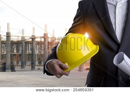 Business Man With Safety Helmet And Construction Of The New Building Site Steel Structure Is Under C