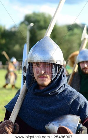 """MOSCOW - SEPTEMBER 5: A warrior marches during the international """"Times and Epoch"""" festival on September 5, 2011 in Moscow.  The festival is dedicated to ancient Slavic culture."""