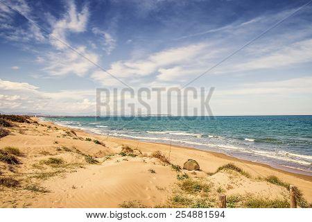fishing in solitude Guardamar del Segura Beach with sand dunes.Alicante, Spain poster
