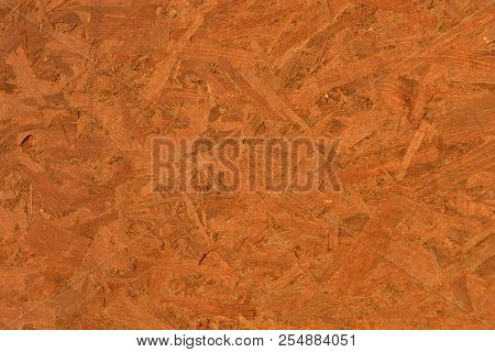 Construction oriented chipboard covered with brown varnish, original woody background plate poster