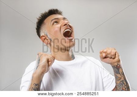 Screaming, Hate, Rage. Crying Emotional Angry Man Screaming On Gray Studio Background. Emotional, Yo