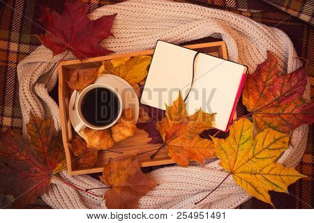 Coffee, Crossants, Opened Notebook, Gray Scarf And Autumn Maple Leaves On Warm Brown Plaid. Autumn F