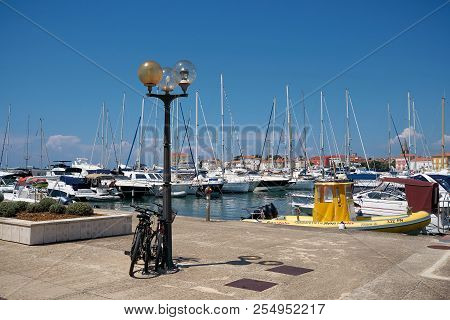 Porec, Croatia - July 22, 2018: View Of The Marina In Porec In Croatia With The Popular Promenade