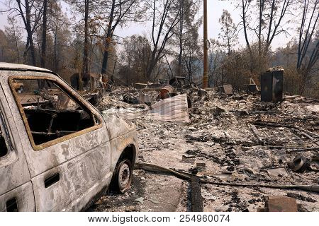 August 16, 2018 In Redding, Ca:  Devastated Property Including A Burnt Home And Car Surrounded By A
