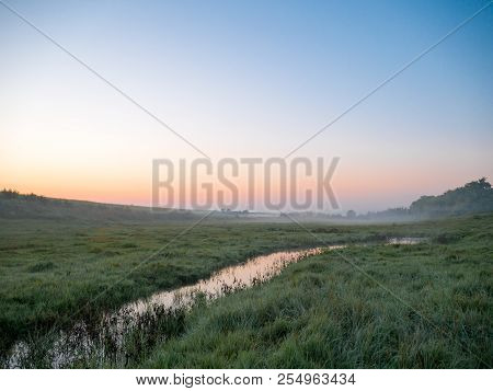 Morning Misty Landscape In A Meadow Stream