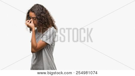 Beautiful young hispanic woman wearing glasses tired rubbing nose and eyes feeling fatigue and headache. Stress and frustration concept.