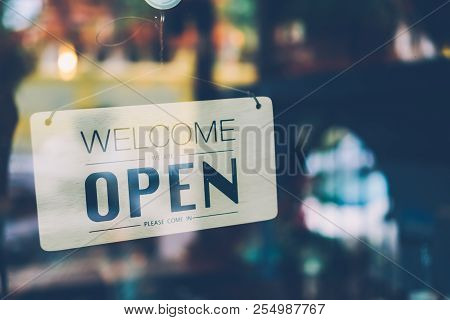 A Business Sign That Says 'open' On Cafe Or Restaurant Hang On Door At Entrance. Vintage Color Tone