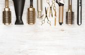 Professional hair dresser tools on wooden background with copy space poster