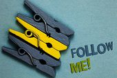 Conceptual hand writing showing Follow Me. Business photo text Inviting a person or group to obey your prefered leadership Gray yellow vintage clothespins clear background Holding things. poster