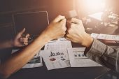 Business Success concept with partner, Partnership Giving Fist Bump after Complete a deal. Successful Teamwork, Businessman with Team Agreement in Corporate. poster