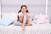 Wish her sweet dreams. Girl child sit on bed her bedroom. Kid prepare go to bed. Pleasant time relax cozy bedroom. Girl kid long hair cute pajamas relaxing before sleep. Time to sleep or nap. poster