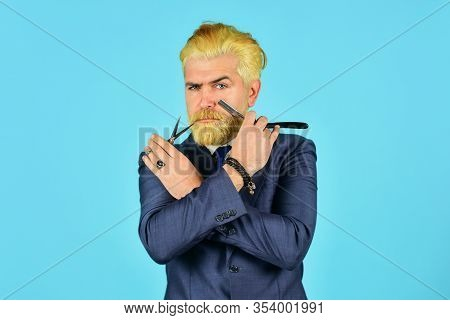 Bleached Hair. Personal Stylist Barber. Bearded Man Hold Razor Scissors. Retro Barbershop. Hipster W