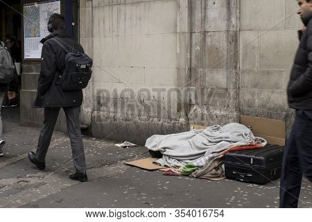 London, Uk - 13 February, 2020 , Homeless Place At Leicester Square Subway. People Pass By