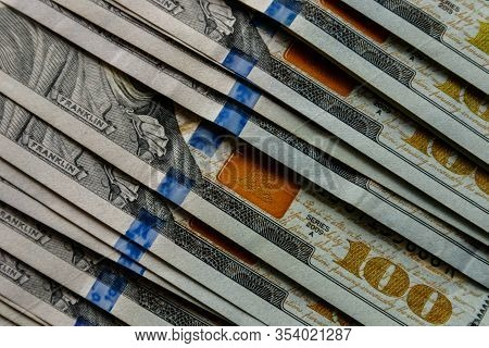 Abstract Textured Backdrop With Hundred Dollar Bills. Hundred Dollar Bills Close-up.