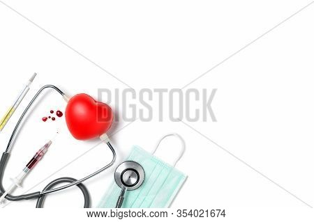 Syring And Blood  With Stethoscope And Little Heart Isolated On White Background, Top View