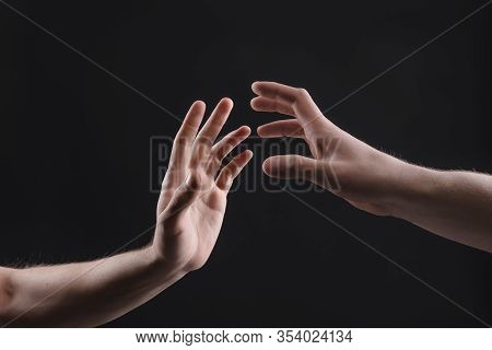 Touch Of 2 X Male Hands On A Gray Background