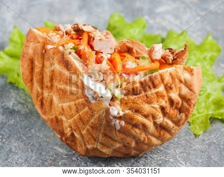 Shaverma In Pita Or Pita Bread With Chicken Fillet And Vegetables