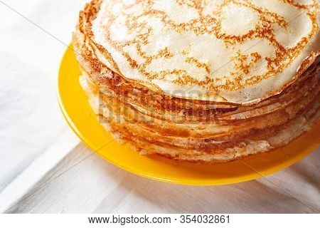 A Stack Of Pancakes. Close-up Fragment Of Thin Hot Pancakes In A Plate. Traditional Rustic Food. Fol