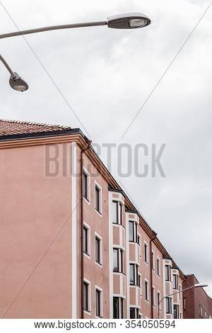 Modern Pink Building And Streetlight. Stockholm, Sweden.