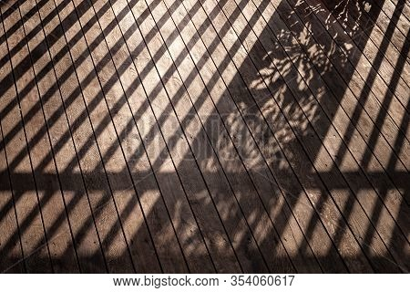 Staircase With A Shadow From The Railing. Staircase With Wooden Steps And A Shadow From The Railing.