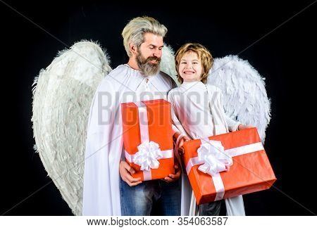 Valentines Day. Cute Angel. Little Angel Boy Gives Father Gift. Happy Father In Angel Costume With L