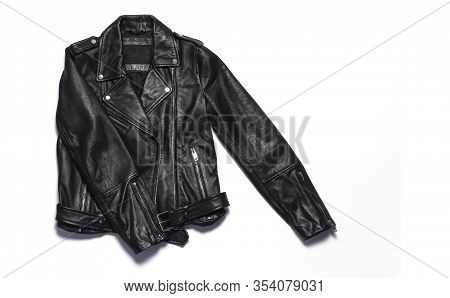 Black Women's Leather Jacket On White Background Top View. Fashionable Modern Trendy Women's Clothin