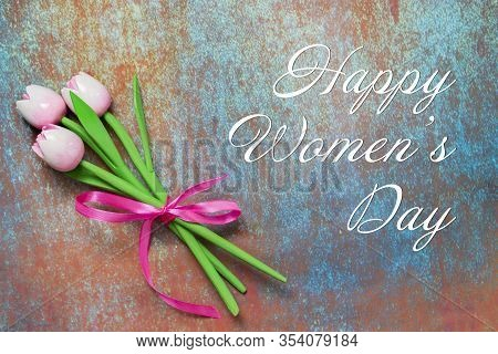 Bouquet Of Three Pink Frayed Wooden Tulip Flowers On A Textured Background. Text Happy Women's Day G