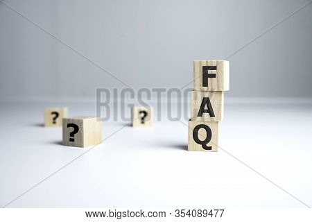 Text Of Faqs On Wooden Cubes, Faq Concept.