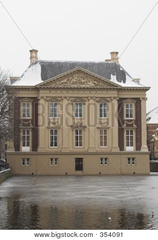 The Mauritshuis Seen From De Hofvijver In The Hague,  During Winter, Covered With Snow.